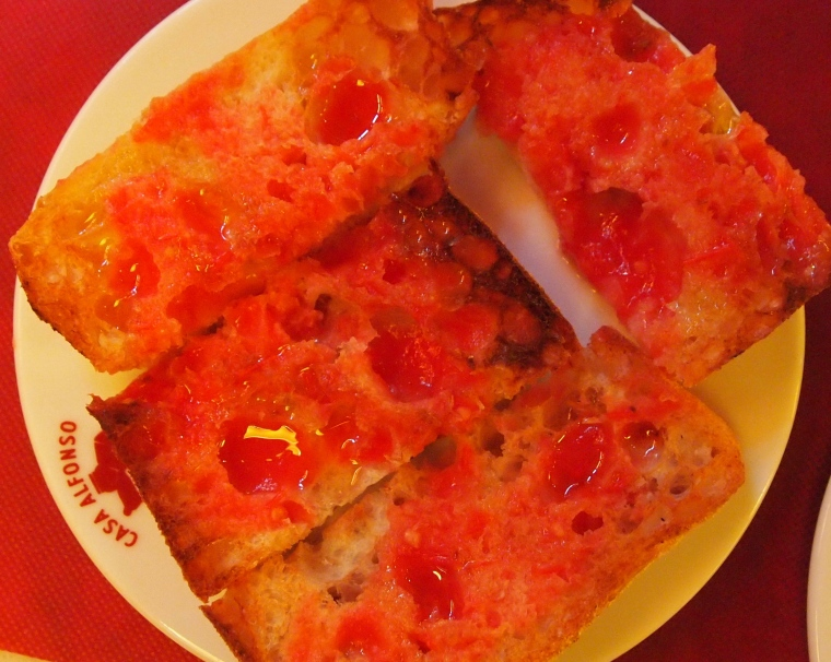 bread with tomato juice and olive oil drizzled over it