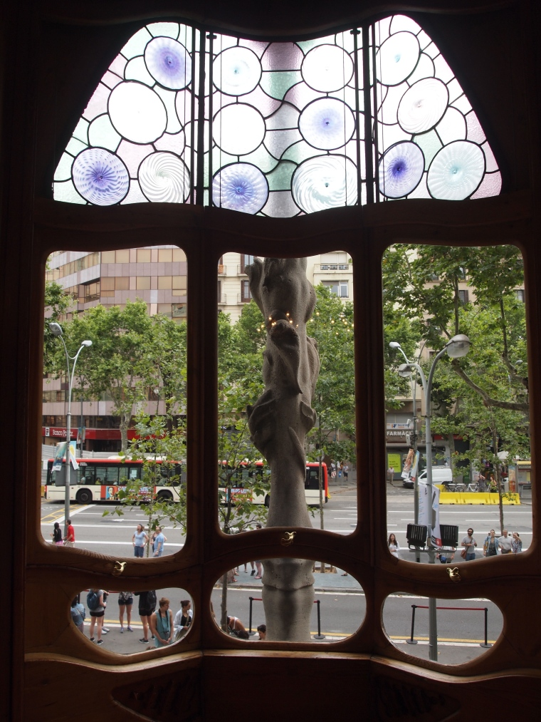 looking out Casa Batlló's front window to the street