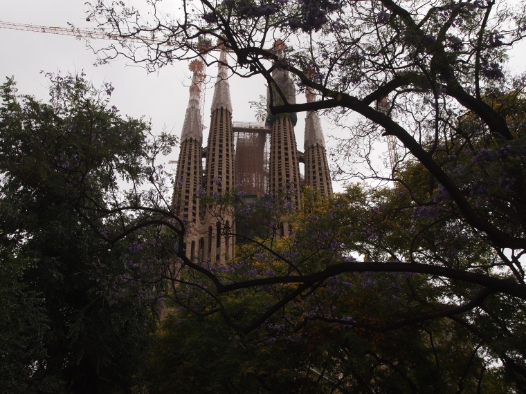 Sagrada Familiar though the trees in the park