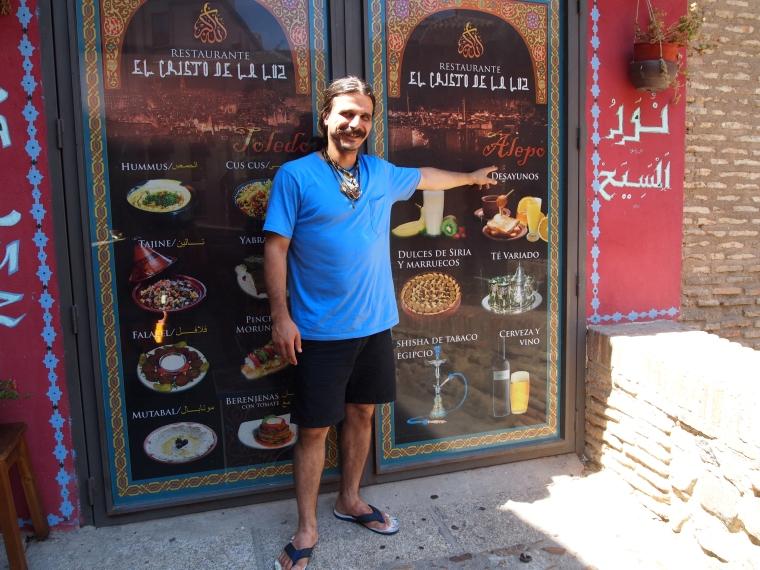the Syrian owner of Posada El Cristo de la Luz points to his hometown of Aleppo