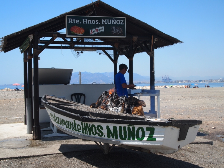 Sardines cooked by the fire at Restaurante Hnos. Munoz by the beach at Malaga