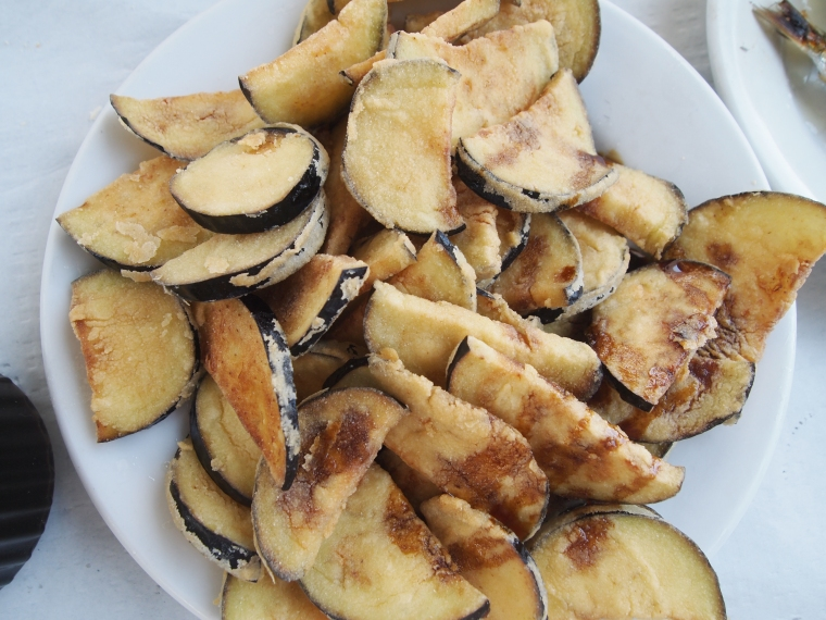 fried eggplants with honey drizzled on top