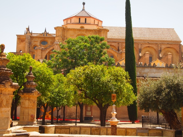 the Cordoba Mezquita from the courtyard full of orange trees