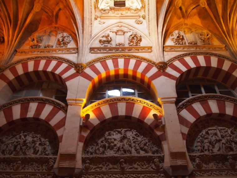 the Mezquita, with its Christian motifs above the arches