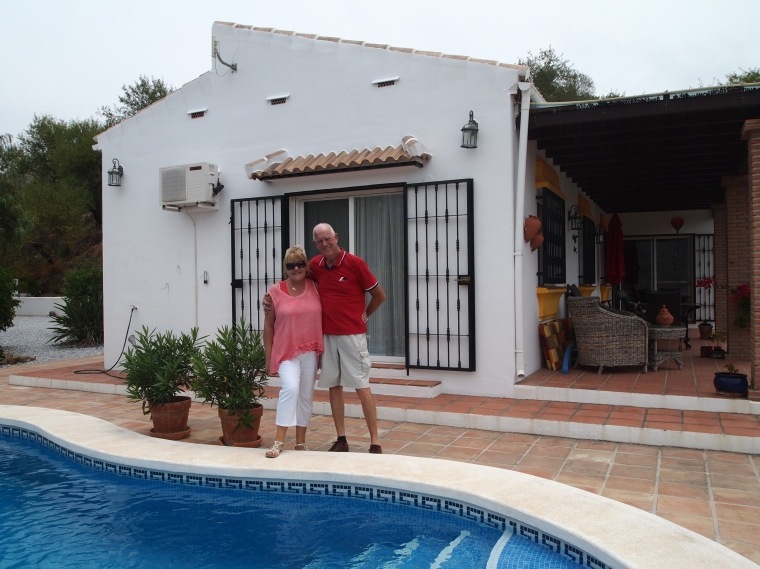 Marianne and Michael beside their pool