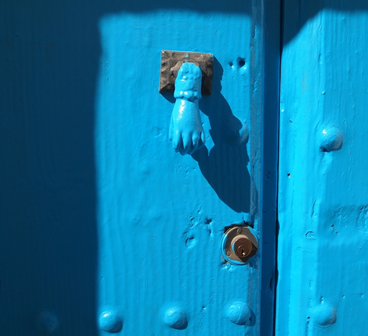 hand of Fatima on a bright blue door
