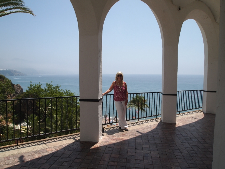 me on beneath some archways on the Balcón de Europa