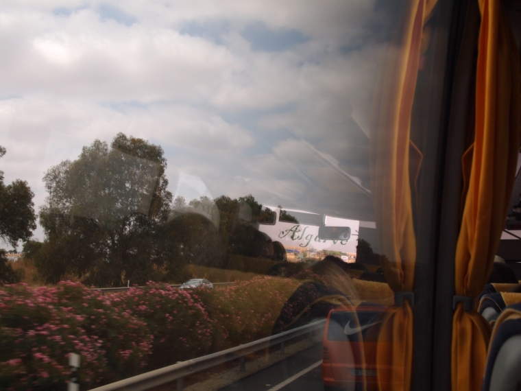 on the EVA bus from Seville to Tavira: note the Algarve sign on the bus reflected in the window