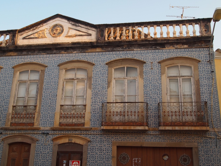 tiled facades on buildings ~ these are all over Portugal
