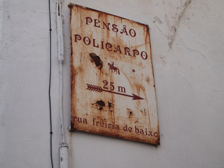 the worn sign for Pensão Policarpo