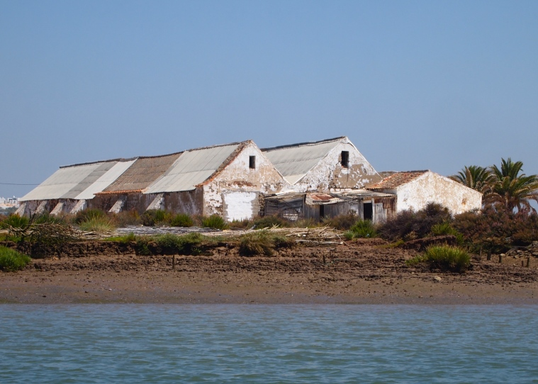an old building on the shore
