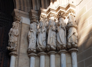 14th century stone apostles at the portal to the Cathedral de Evora