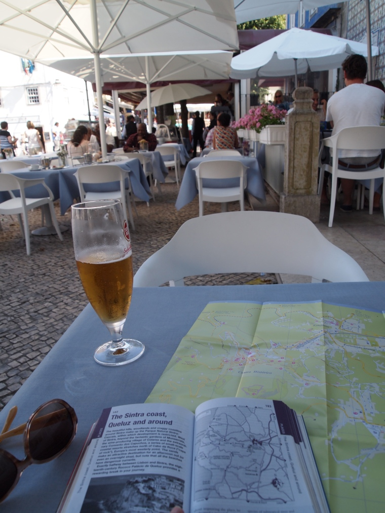 relaxing with a beer and the Lisbon guidebook