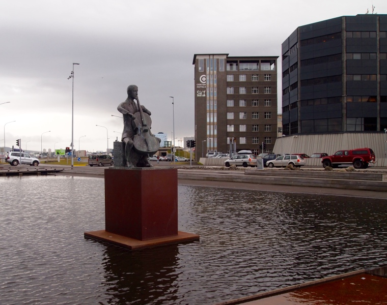 statue in front of Harpa