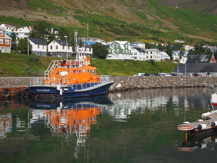 orange boat in the harbor