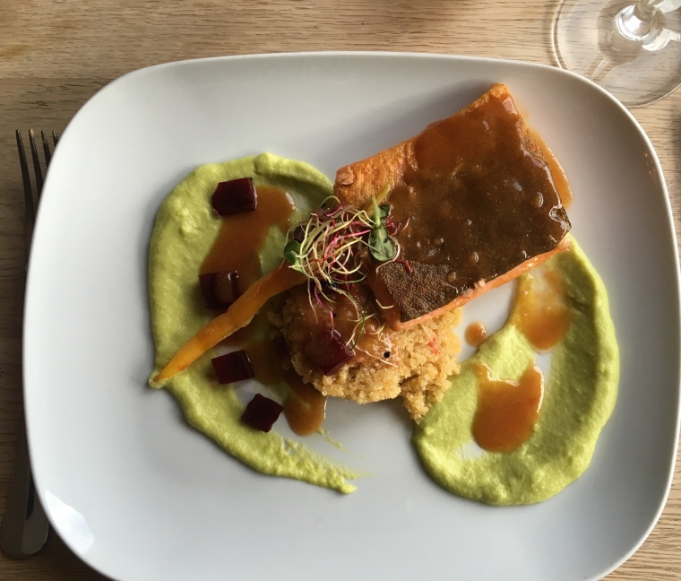 Arctic Char fillet served with broad bean puree, roaste beets and a bisque emulsion.