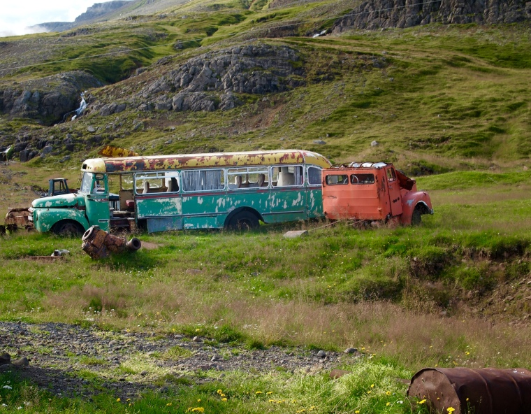 a rusty abandoned bus
