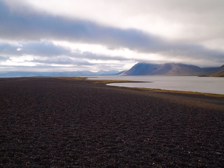 the black sand and pebble beach at Lón