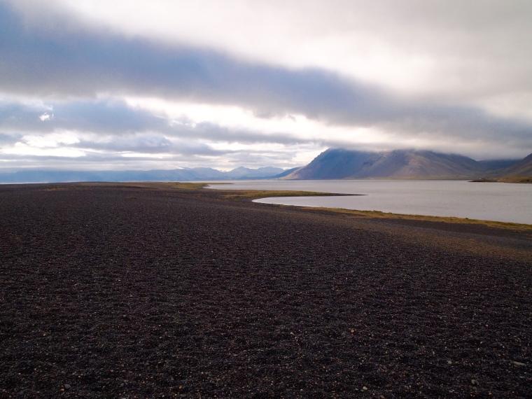 the black sand and pebble beach at Lón