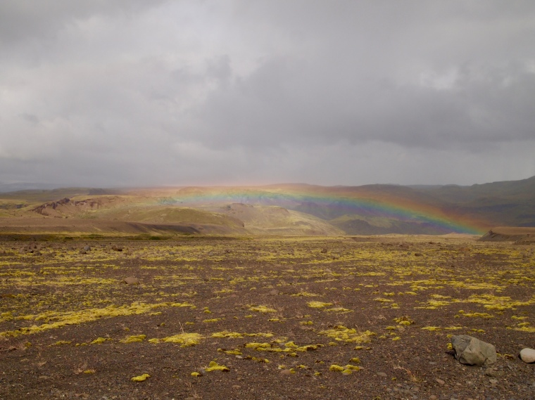a rainbow on the drive to the Sólheimajökull glacier tongue