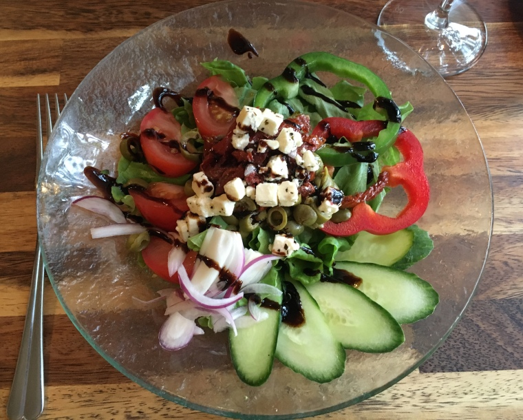 salad with sun-dried tomatoes, olives and feta cheese