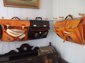 satchels on the walls of the Old Schoolhouse