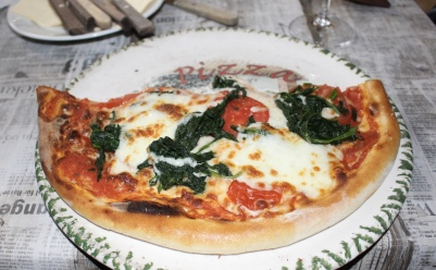 pizza with spinach and cheese at Forum Pizzeria