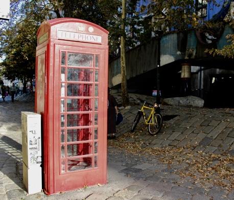 red phone booth at Hundertwasserhaus