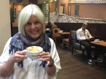 me having coffee in Lucerna Arcade